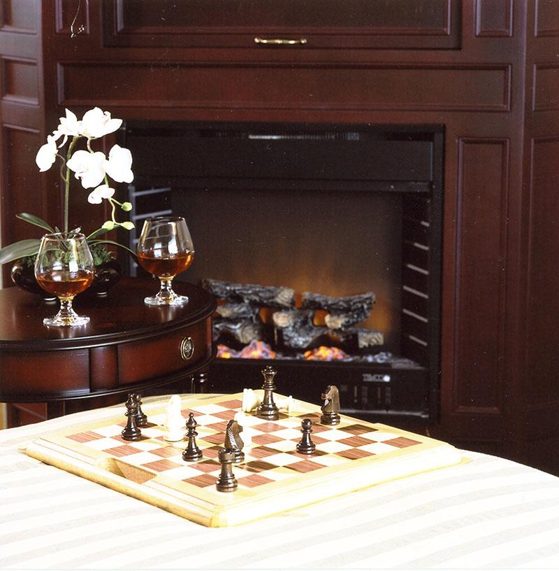 Chess table next to fireplace
